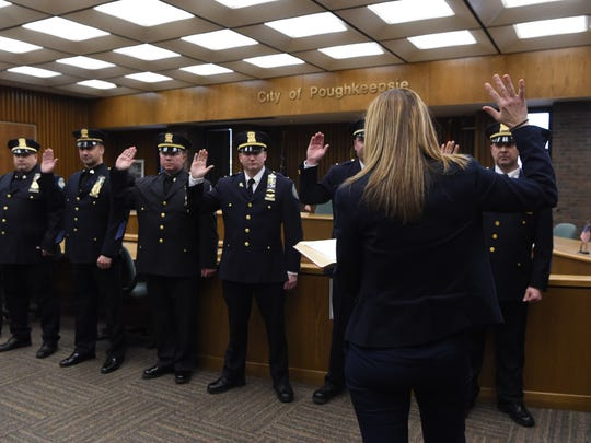 City Chamberlain Deanne Flynn officiates a promotion ceremony for several City of Poughkeepsie police officers at City Hall.
