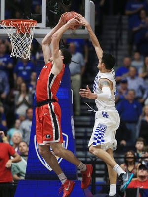 Derek Willis gets up for a block in transition Saturday against Georgia.