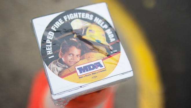 Donors to the firefighters' annual Fill the Boot fundraiser receive a sticker to show their support for the Muscular Dystrophy Association, which benefits from the campaign. This year's event, however, has been moved online due to COVID-19 concerns.