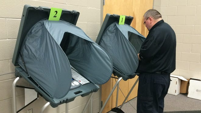 Richmond firefighter Shawn Staton is the first to vote Tuesday morning at First English Lutheran Church.