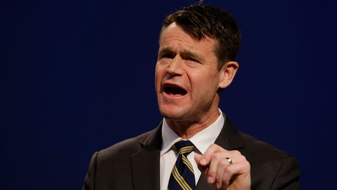 Indiana Republican candidate for U.S. Senate Todd Young speaks debate with opponent Marlin Stutzman watches as  in Indianapolis, Monday, April 18, 2016. (AP Photo/Michael Conroy)