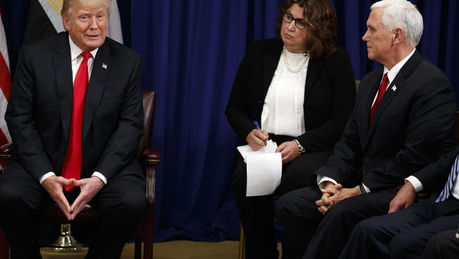 Vice President Mike Pence listens as President Donald Trump talks to reporters about the Graham-Cassidy health care bill during a meeting with Egyptian President Abdel-Fattah el-Sissi at the Palace Hotel during the United Nations General Assembly, Wednesday, Sept. 20, 2017, in New York. (AP Photo/Evan Vucci)
