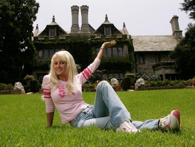 Holly Madison, one of Hugh Hefner's three girlfriends,