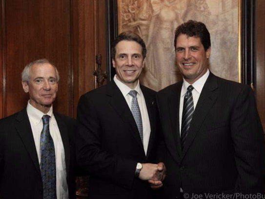 Gov. Andrew Cuomo, center, is pictured with COR Development