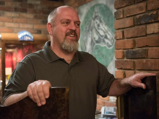 Mike Kline discussed his new Detroit bar guide at Green Dot Stables, one of his favorite watering holes.