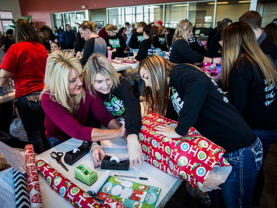 Hundreds of volunteers gather at Toyota of Muncie to
