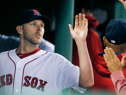 Boston Red Sox's Chris Sale enters the dug out after pitching during the fourth inning of a baseball game against the Baltimore Orioles, Tuesday, May 2, 2017, in Boston. (AP Photo/Michael Dwyer)