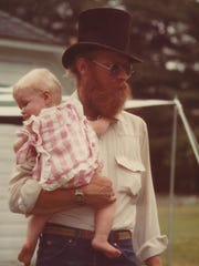 Gary 'Bonz' Saddlemire holds his daughter, Erin Saddlemire VanNosdall.