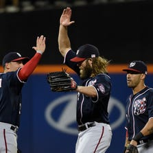Sep 11, 2014; New York, NY, USA; Washington Nationals right fielder Jayson Werth (center) celebrates the win with Asdrubal Cabrera (left) and shortstop Ian Desmond (right) after the game against the Washington Nationals at Citi Field. Mandatory Credit: Robert Deutsch-USA TODAY Sports