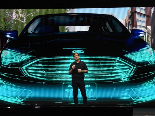 Ford Motor Co. Executive Vice President and President, Global Markets, Jim Farley speaks during a keynote address by Ford Motor Co. President and CEO Jim Hackett at CES 2018 on January 9, 2018 in Las Vegas, Nevada.