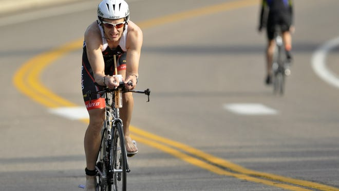 Triathlon deaths are rare, though two people have been killed in Northern Colorado triathlons. Here, a triathlete participates in the Fort Collins Triathlon at EPIC.