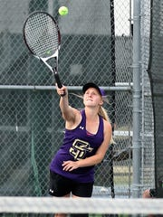 Sterling City's Brooke Rauch serves during mixed doubles action at the Region II-1A Tennis Tournament Thursday at Bentwood Country Club.