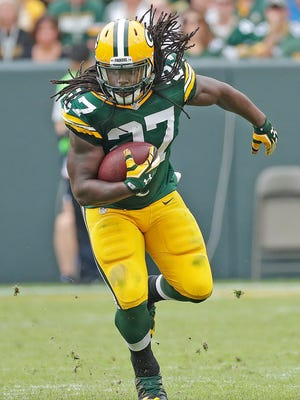 Green Bay Packers running back Eddie Lacy (27) runs the ball against the Detroit Lions at Lambeau Field on Sept. 25, 2016.