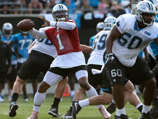Carolina Panther quarterback Cam Newton (1) looks to throw a pass during practice at NFL football training camp at Wofford College in Spartanburg, S.C., Wednesday, July 26, 2017. (AP Photo/Chuck Burton)