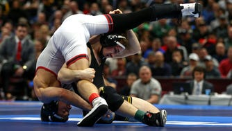 Mar 17, 2018; Cleveland, OH, USA; Rutgers Scarlet Knights wrestler Nick Suriano competes against Iowa Hawkeyes wrester Spencer Lee during the NCAA Wrestling DI Wrestling Championships at Quicken Loans Arena.