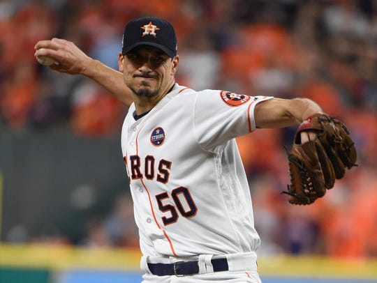 Houston Astros starting pitcher Charlie Morton throws