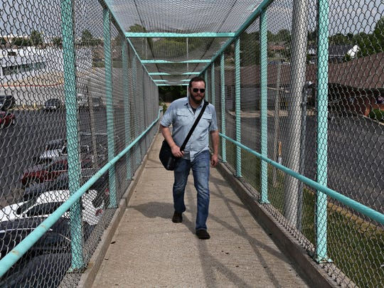 A trip to the Library Center required getting off the Line 12 bus at Primrose Street and South Avenue and using the pedestrian bridge to cross Campbell Avenue to catch the Line 7 bus.