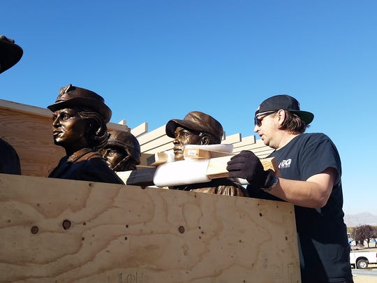 Matt Glenn, the artist who crafted six statues commemorating women's service in the military, helps unpack the sculptures from a shipping crate on Wednesday, Dec. 20, 2017, in Las Cruces. Glenn created the sculptures in Utah, and they were shipped to Las Cruces via truck.