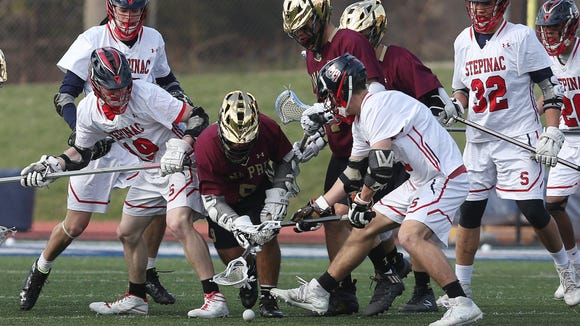 Iona and Stepinac players battle for ball control during