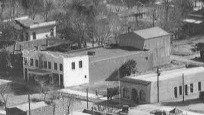 A detail of a 1930s aerial view shows the white-front Goodwin Opera House and skating rink at center. The stage house addition completed in 1907 is shown at the rear.