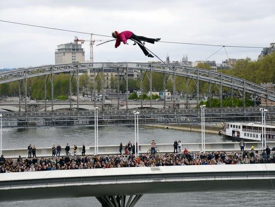 Tightrope walker above Seine river