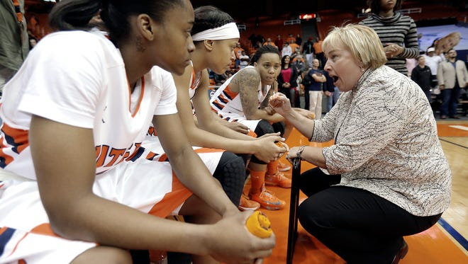 UTEP women's head basketball coach Keitha Adams talks to her starting five as they prepare to take the court. The Miners play Old Dominion on Thursday.