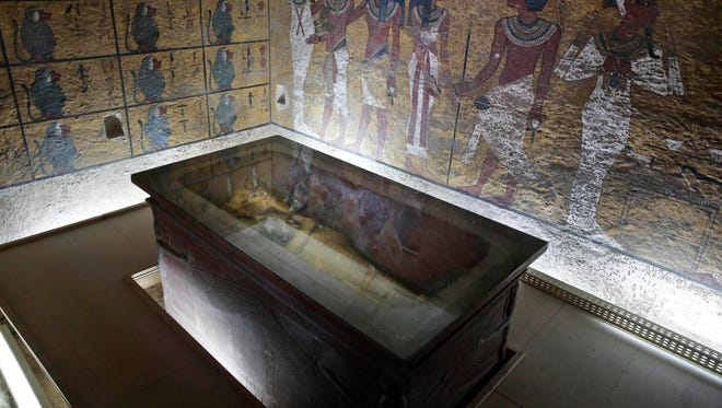 FILE -- In this Tuesday, Sept. 29, 2015 file photo, the tomb of King Tut is displayed in a glass case at the Valley of the Kings in Luxor, Egypt, Tuesday.
