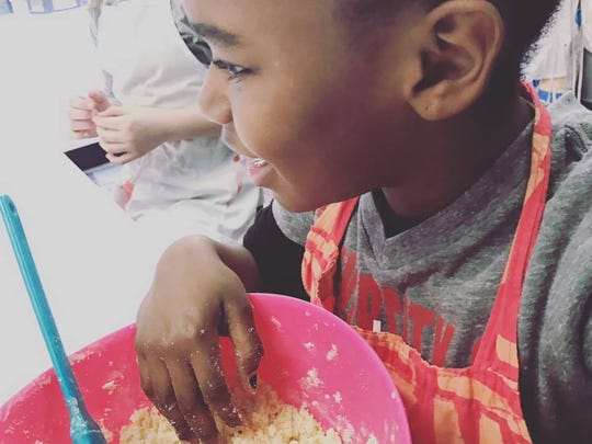 Jordan Dungee, 9, in a pastry lesson class at Turnip