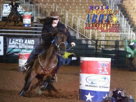 Taylor Zbytek and her pony, Sassy, winning the 2014 National Barrel Horse Association world championship last month.