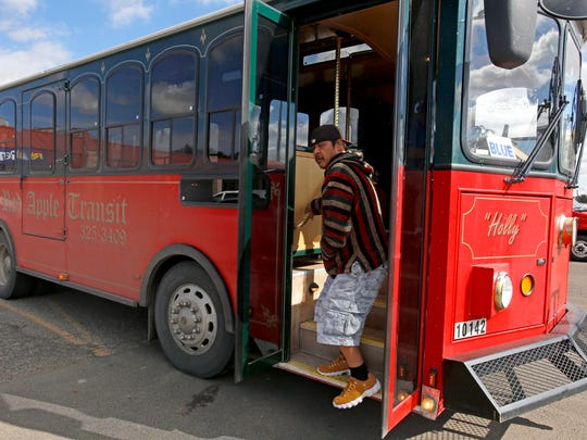 A passenger exits a blue line bus on Friday at a Red Apple Transit stop on Farmington Avenue.