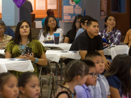 Friends and parents of students at Dream Diné Charter School watch an end-of-the-year program Friday at the Shiprock Chapter House.