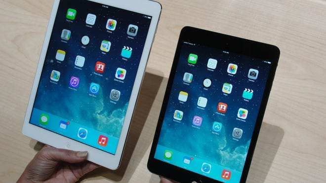 Apple's iPad Air, left, and iPad Mini tablets in October.