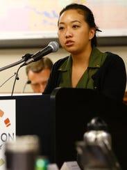 Kue Her speaks on behalf of County Administrator Brad