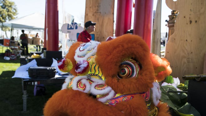 Phoenix residents enjoy at the 26th annual Phoenix Chinese Week's Culture and Cuisine Festival at Margaret T. Hance Park in downtown Phoenix on Feb. 12, 2016.  A Year of the Monkey in Chinese horoscope.