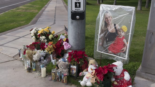 Memorial where Pamela Hesselbacher was killed in November while she was crossing a street near their home with Ryan and Audrey were run over by a pickup driven by a man with a suspended license at the intersection of Ray Road and Ponderosa Avenue in Chandler, Az.