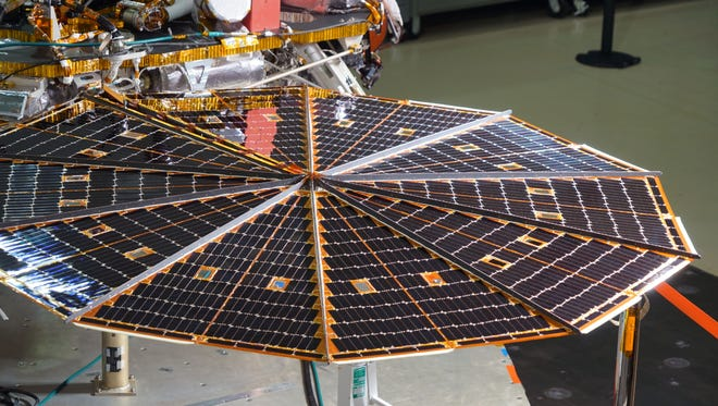 A solar array on the InSight Mars Lander gleams beneath lights being used to test the array's power-generating ability during testing at the Lockheed Martin satellite facility outside Denver  in January before being packaged for transport to the launch site in California.