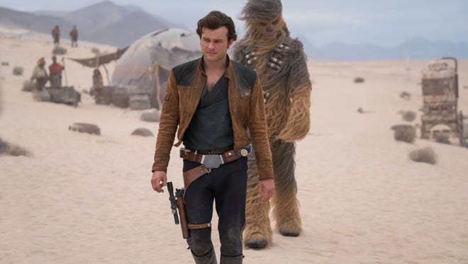 """This image released by Lucasfilm shows Alden Ehrenreich and Joonas Suotamo in a scene from """"Solo: A Star Wars Story."""" (Jonathan Olley/Lucasfilm via AP)"""