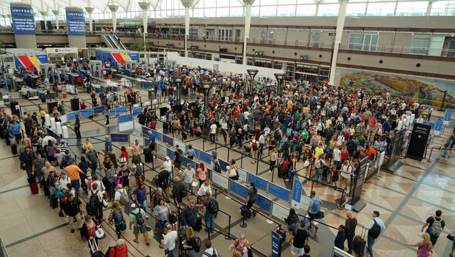 Hundreds of flyers wait in TSA security lines in Denver International Airport's Great Hall. Airport managers have launched a major renovation of the hall, hoping to speed up security screenings and improve the passenger experience.