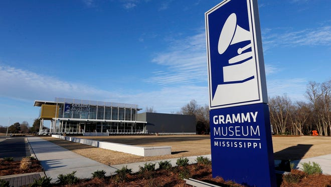 In this Wednesday, March 2, 2016 photo, a large roadside sign touts the new Grammy Museum Mississippi in Cleveland, Miss. The second and only official Grammy Museum outside of Los Angeles opens Saturday in the Mississippi Delta, cradle of the blues. Organizers chose Cleveland, Miss. - two hours north of the state capitol Jackson - for the nearly $20 million project and promise one of the most advanced museums in the country. (AP Photo/Rogelio V. Solis)