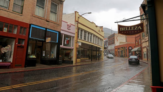 A fierce rain falls in Old Town Bisbee, Arizona, sending shoppers running for cover.