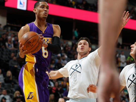 Los Angeles Lakers guard Jordan Clarkson, left, drives to the net as Denver Nuggets forward Danilo Gallinari, of Italy, defends in the first half of an NBA basketball game Monday, March 13, 2017, in Denver. (AP Photo/David Zalubowski)