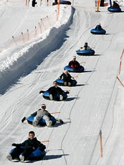 Tubers are carried up to the top of the tubing run at Brian Head Resort.