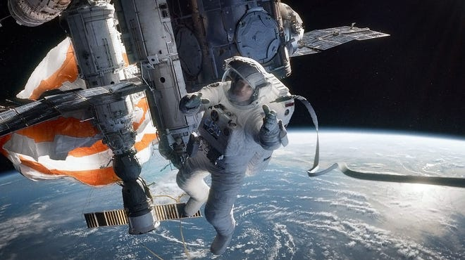 "The debris from a destroyed satellite wreaks havoc in ""Gravity,"" a movie starring Sandra Bullock."