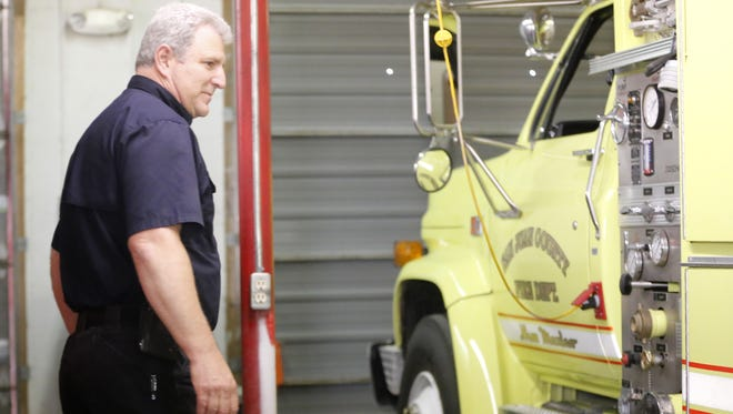 Flora Vista Fire Department Division Chief Kevin Jones shows the old mini-pumper truck that needs to be replaced on Wednesday at the fire station in Flora Vista.