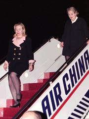 Hillary Clinton arrives in Beijing with U.S. Ambassador