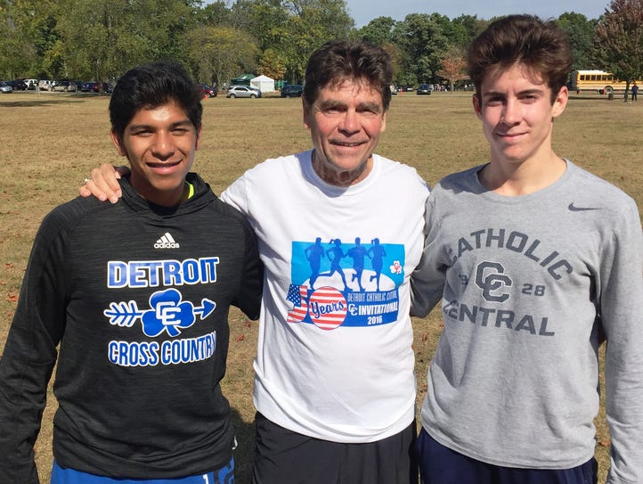 Catholic Central's Tony Magni (middle), in his 53rd