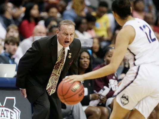 Mississippi State head coach Vic Schaefer, left, calls to his players during the first half of an NCAA college basketball game against Connecticut in the semifinals of the women's Final Four, Friday, March 31, 2017, Friday, March 31, 2017, in Dallas. (AP Photo/LM Otero)