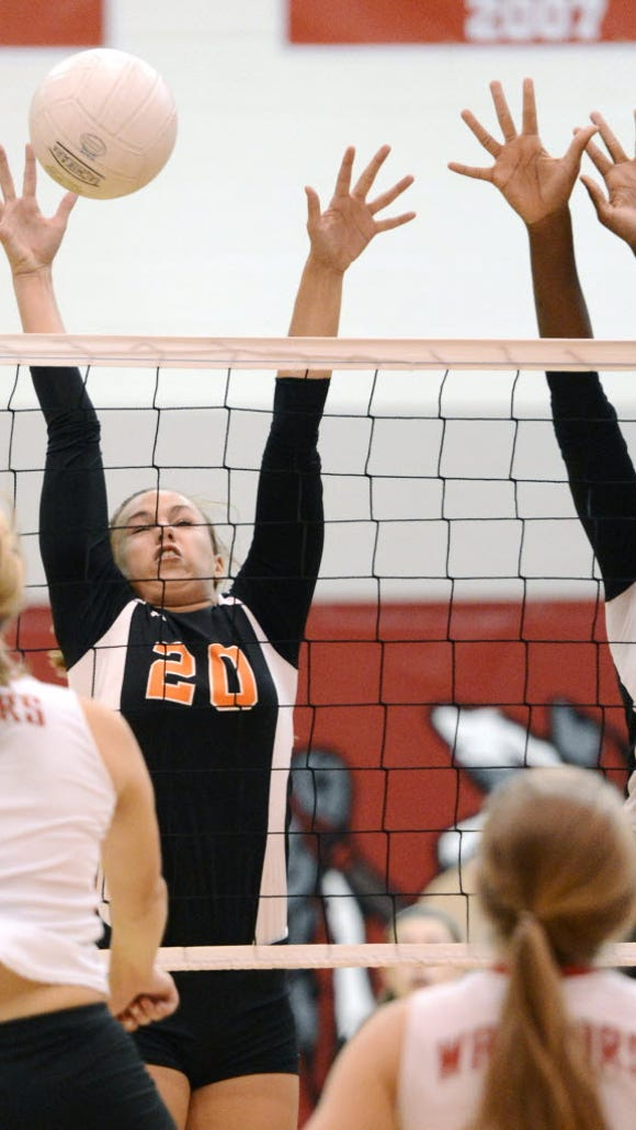 Susquehannock's Abigail Bentz, left, fires one over the net to Central's Erin Dobbeck, center, and Andrea Quartey, right, as Susquehannock's Beth Garrison looks on. Dobbeck, Quartey and Bentz are all back for their teams. (DAILY RECORD/SUNDAY NEWS -- KATE PENN)  YORK DAILY RECORD/SUNDAY NEWS -