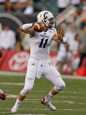 UC's Gunner Kiel throws during the first quarter Friday at Paul Brown Stadium against Toledo.