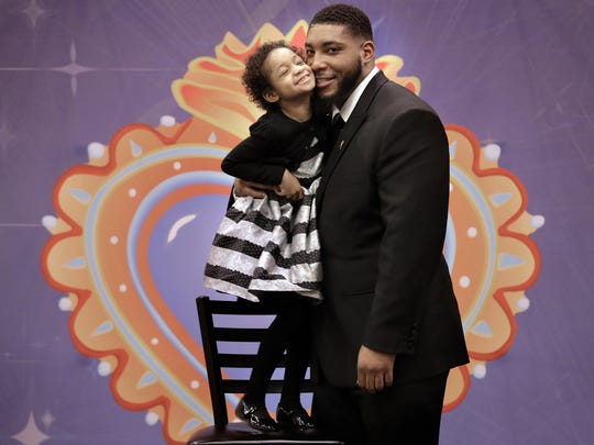 Leah Still poses for a photo with her dad, Houston Texans defensive end Devon Still, at the El Paso Children's Hospital Foundation's Milagro Gala on Friday night at the Judson F. Williams Convention Center. Leah was the gala's guest of honor, along with her dad, who was the keynote speaker.